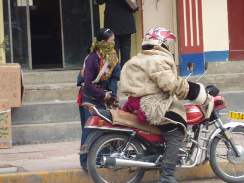 "A Tibetan family going home...the Dalai Lama calls Chinese action towards these people ""cultural genocide""."