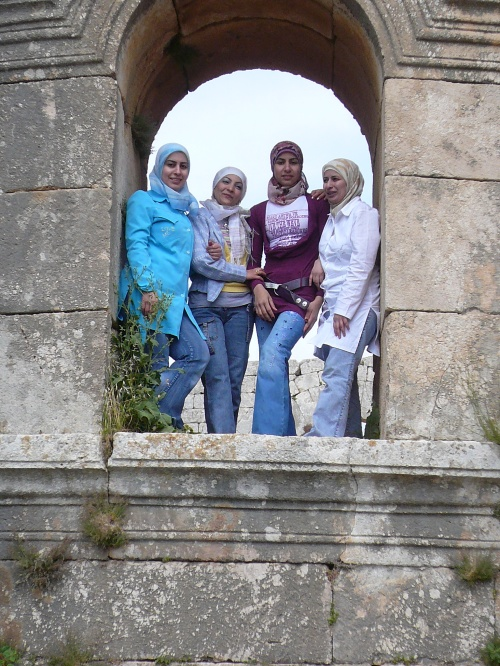 Young girls pose in the window at the Basilica St Simeon where the saint was said to have lived on a platform atop of a pillar 15 metres high for 37 years