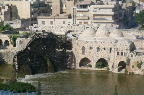 The water wheels at Hama. Around the corner the buildings have bullet marks from an earlier uprising. Ham