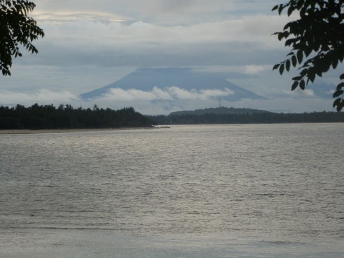 Bali's volcano, Gung Agung, can be seen from this coastline.
