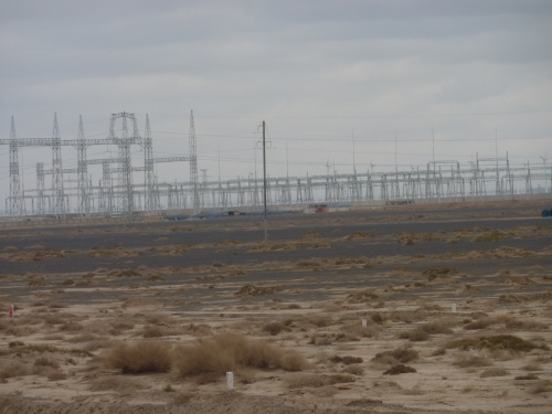 "Now, these transmission lines cross the Gobi desert in the once ""Unknown""."