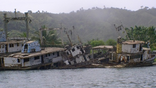 The 1994 eruption destroyed the boats at anchor in the harbour; squatters live on one of these