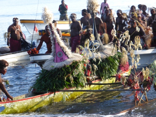 The Tubuans, not usually viewed by the women, are brought across by boat from the Duke of York islands