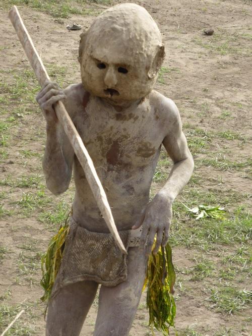 The mudmen eerily silent creep across the field