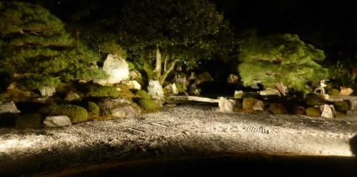 A zen garden by lantern light