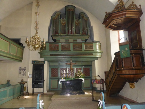 Before this very Lutheran altar.