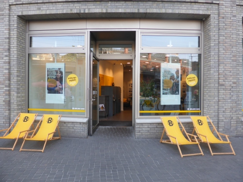 A bank agency where you can't withdraw money but you can sit in the deck chairs on the street.