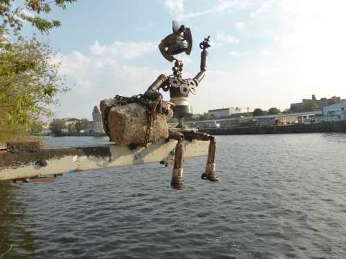 This little vela swings out over the river in front of a the reggae  Yaam bar with sandy floor in Friedrichhhshain