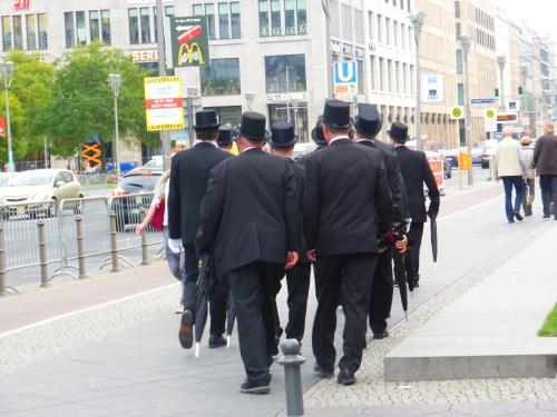 Out os the blue these dinner suited gents came strolling along at Potsdamer Platz in neat formation.