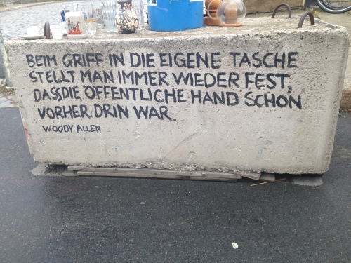 Concrete blocks hold the blue drainage pipes and on many a block is an exhortation from a famous person Goethe, Dante, Voltaire, Gandhi, U.Ecco. This one was from Woody Allen and roughly translates as: