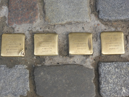 Bronze plaques in the cobble stones commemorating holocaust victims who lived nearby