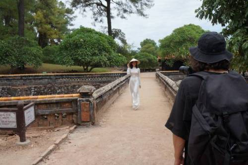 A young woman models for a Russian photographer what a sight it once might have been in the Hue Imperial Palace